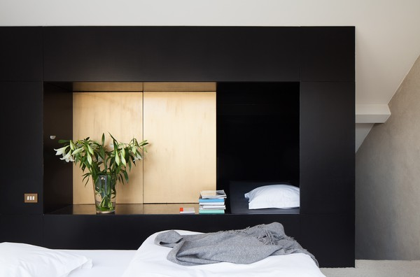 black built in plywood storage in bedroom at shelter7
