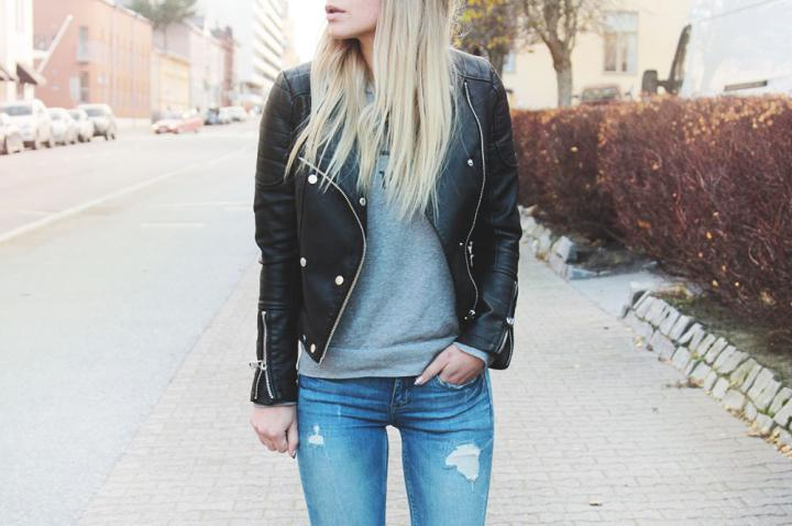 blue ripped jeans grey sweater black leather jacket outfit