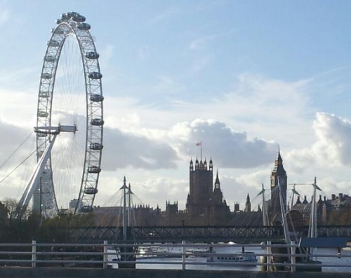 The Eye of London to the right, The Palace of Westminster in the center and Big Ben to the left. Picture taken from Waterloo Bridge..