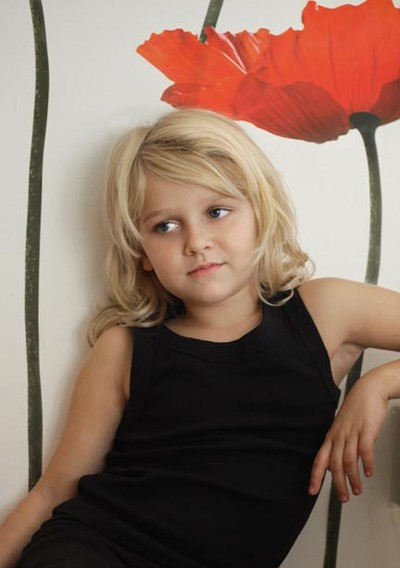photo of young girl in front of flower. Photo by Anne Muscat Scerri, Photography Services Malta