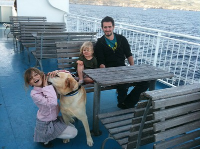 Kids with dog on the ferry between Gozo and Malta