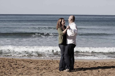 Couple dancing on the sand in Ghajn Tuffieha beach, Malta