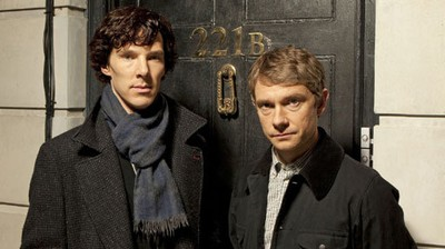 Sherlock (Benedict Cumberbatch) and John (Martin Freeman) outside 221b Baker Street.