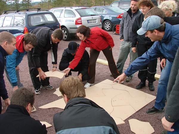 Loxodonta teambuilders solving giant jigsaw puzzle