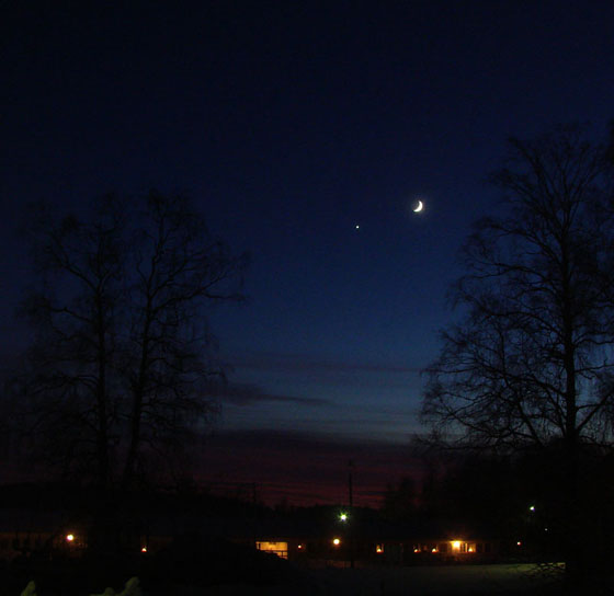 Venus and new moon after winter sunset