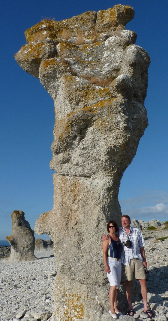 Anette and Dan with high stone pillar at Langhammars